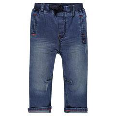 Jeans effet used à taille élastiquée et poches