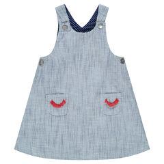 Αμάνικο φόρεμα-σαλοπέτα με τσέπες και κεντημένες βλεφαρίδες