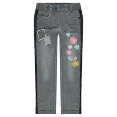 Skinny τζιν με used όψη, κεντημένα λουλούδια και τρέσα με κρόσσια