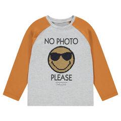 Μακρυμάνικη δίχρωμη μπλούζα ζέρσεϊ με μοτίβο ©Smiley από «μαγικές» πούλιες