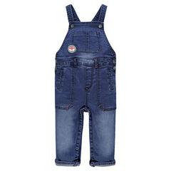 Salopette longue en jeans effet used avec badge tête de renard