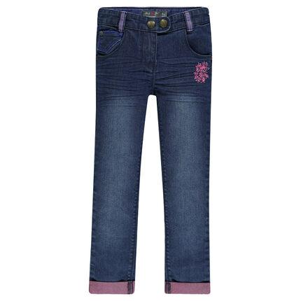 Jeans slim effet used avec broderie fantaisie
